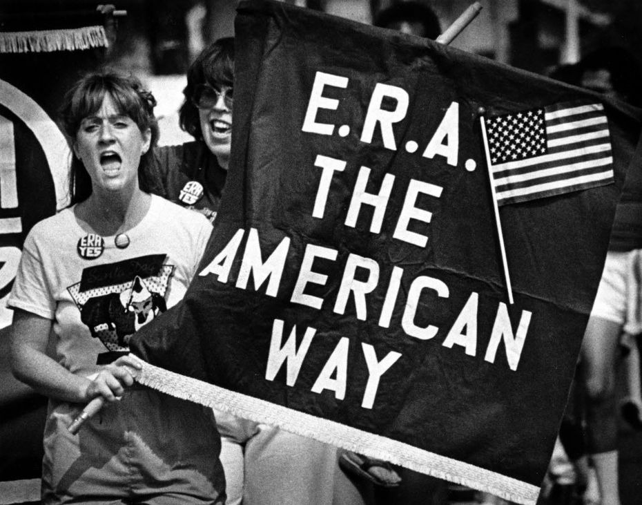 A supporter of the Equal Rights Amendment chants slogans with about 150 marchers who participated in an ERA walkathon in Dallas in 1981.