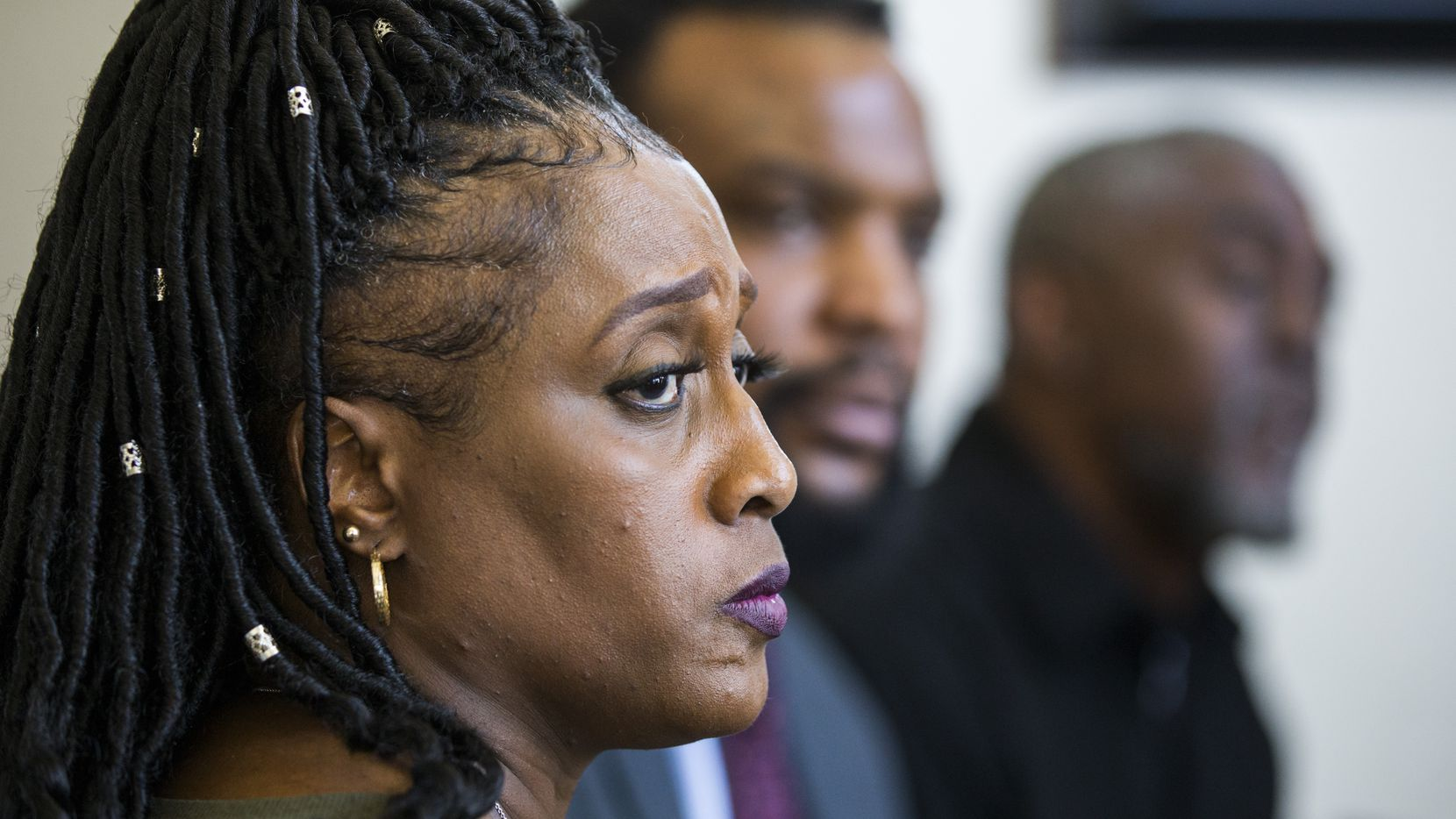 Froncella Reece, mother of Darius Tarver, speaks to reporters with Attorney Lee Merritt (center) and Kevin Tarver (right), father of Darius Tarver, at Merritt's home on Friday, March 6, 2020 in McKinney. Tarver, a UNT student was killed by Denton police in January. (Ashley Landis/The Dallas Morning News)