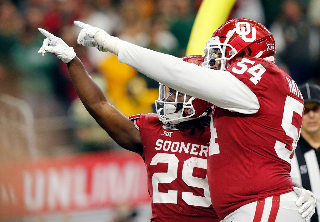 Oklahoma Sooners offensive lineman Marquis Hayes (54) celebrates Oklahoma Sooners running back Rhamondre Stevenson's (29) overtime touchdown against the Baylor Bears in the Big 12 Championship at AT&T Stadium in Arlington, Saturday, December 7, 2019. Oklahoma won in overtime, 30-23.