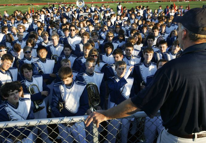 Allen High band director Charles Pennington addressed the Eagle Escadrille marching band - then 600-plus members strong - before a 2009 football game. The Escadrille is believed to be the nation's largest band, with a membership of 850, including musicians, drill team and color guard.