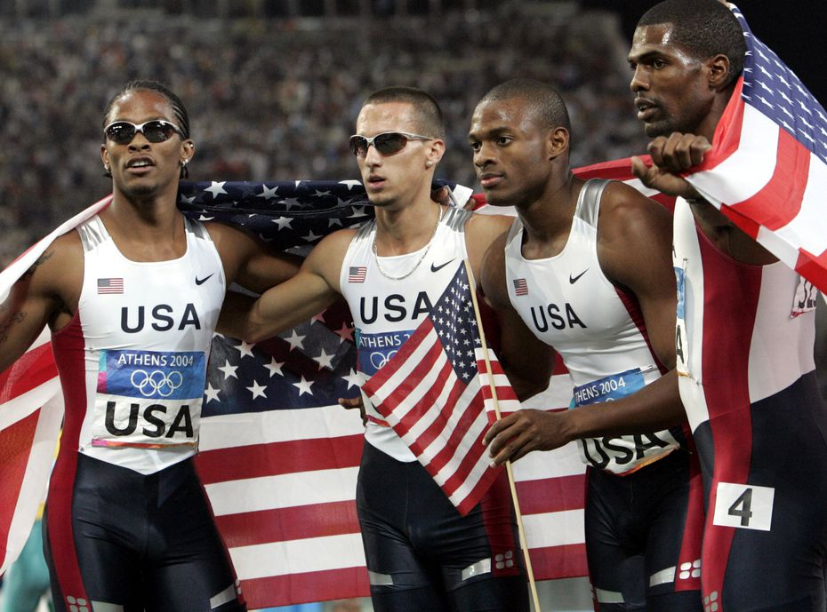 2004 Summer Olympic Games (L-R): The United States' Darold Williamson, Jeremy Wariner , Otis Harris and Derrick Brew celebrate after winning the gold medal in the 4 x 400 meter relay at the Olympic Stadium during the 2004 Olympic Games in Athens, Saturday, Aug. 28, 2004.