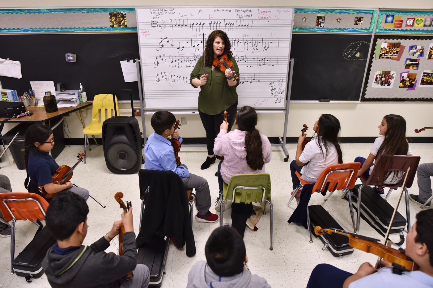 "Professional Nicole Melki leads classes three days a week at Zaragoza Elementary. The school's counselor, Kristella Longoria, says Nicole's teaching is ""worth gold when it comes to brain development."""