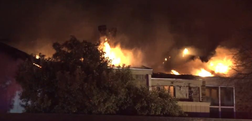 Fire quickly spread to the roof of a condominium complex in Lake Highlands on Monday night.