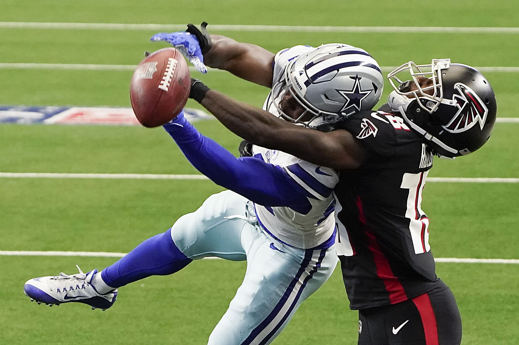 FILE - Cowboys cornerback Chidobe Awuzie (24) breaks up a pass intended for Falcons wide receiver Calvin Ridley (18) during the first quarter of a game on Sunday, Sept. 20, 2020, at AT&T Stadium in Arlington.