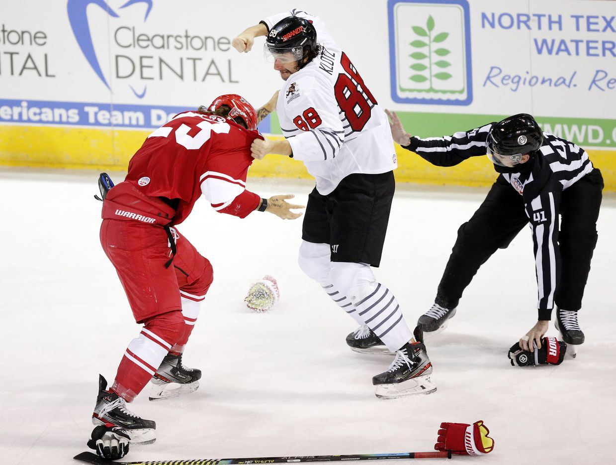 Allen Americans defenseman Cole Fraser (23) and Rapid City Rush forward Garrett Klotz duke it out during a third period fight at the Allen Event Center in Allen, Texas, Friday, December 18, 2020. Both were escorted off the rink with penalties. This is the first professional hockey game in the metroplex since March. (Tom Fox/The Dallas Morning News)
