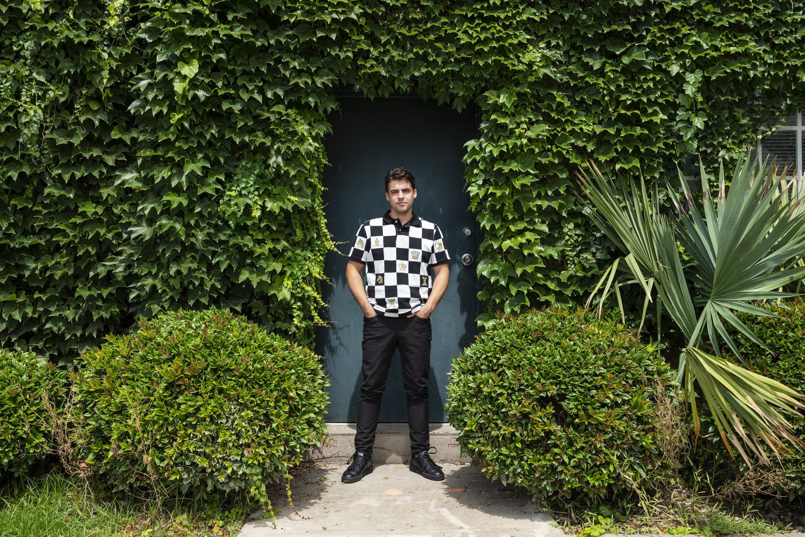 Kevin Rubén Jacobs outside of his ivy-clad Olivier François Galerie in Dallas' Exposition Park in July 2021.