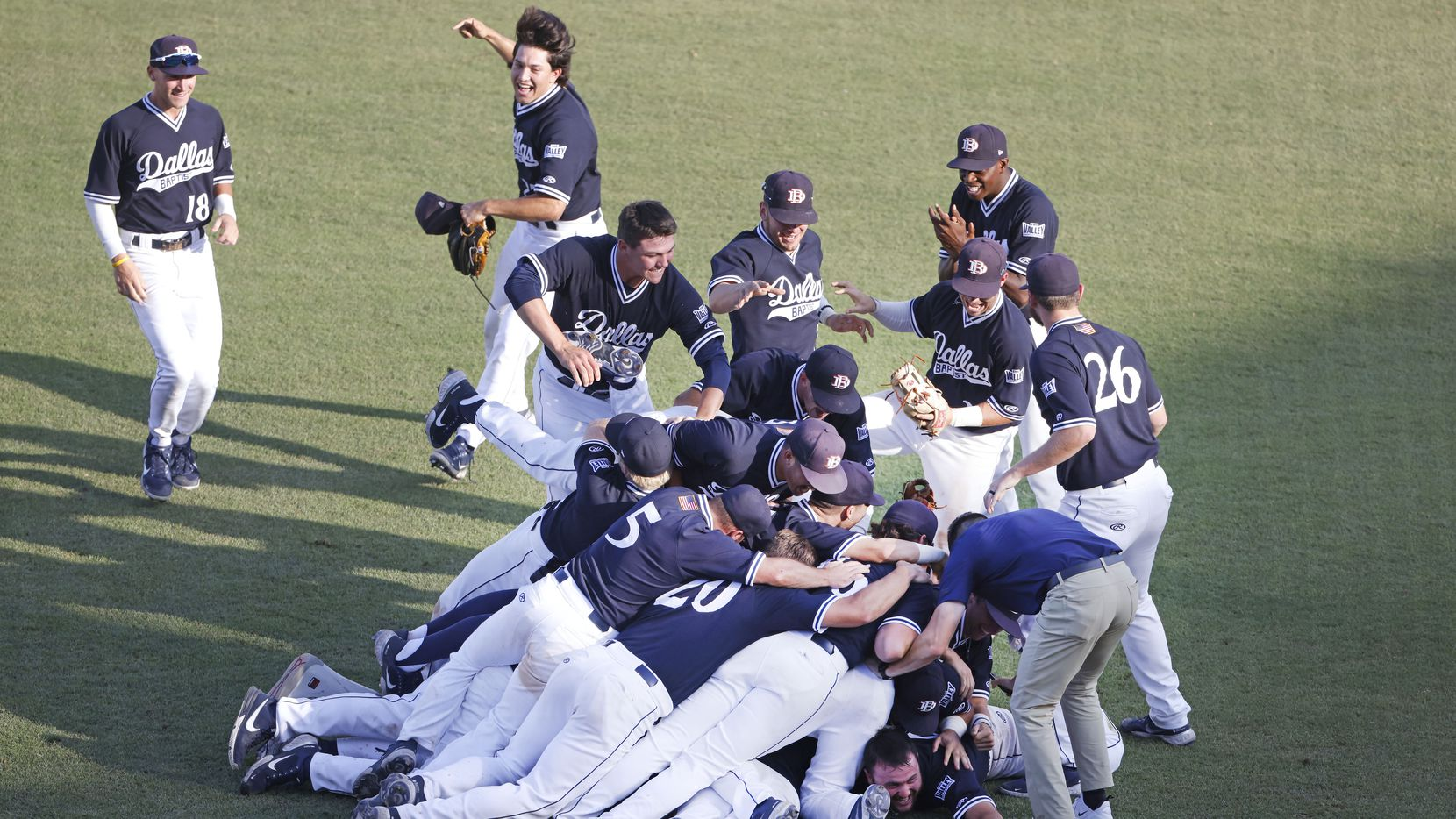 Dallas Baptist celebrates their 8-5 win over Oregon St. following the NCAA Division I Baseball Regional Championship game in Fort Worth, Texas on June 7, 2021.