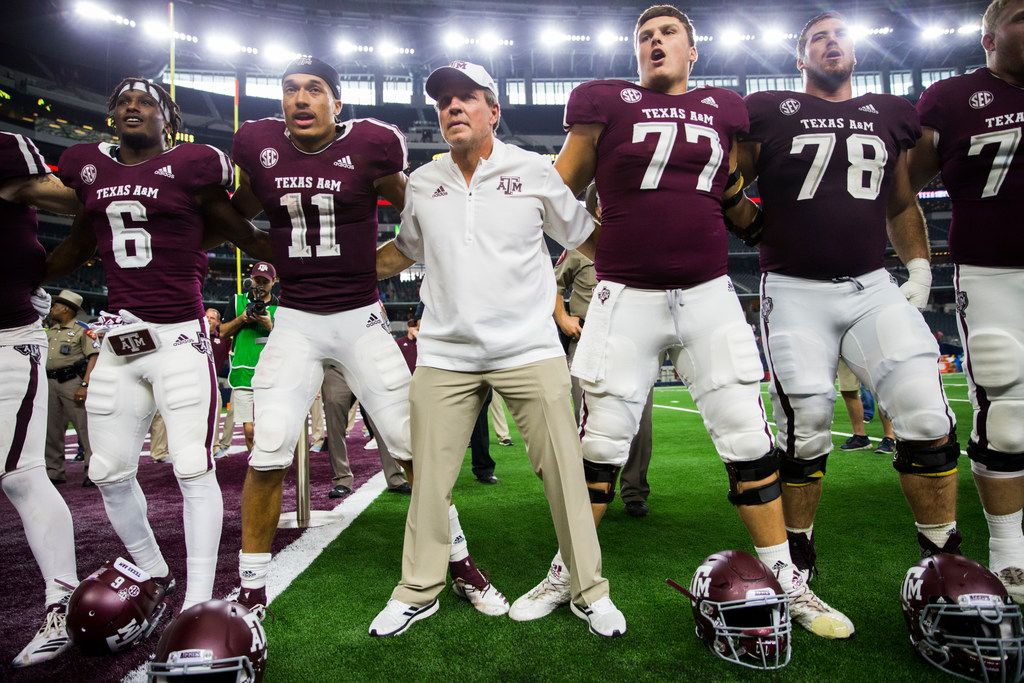 Texas A&M Aggies head coach Jimbo Fisher and the Texas A&M Aggies sing the Aggie War Hymn after a 24-17 win over the Arkansas Razorbacks on Saturday, September 29, 2018 at AT&T Stadium in Arlington, Texas. (Ashley Landis/The Dallas Morning News)