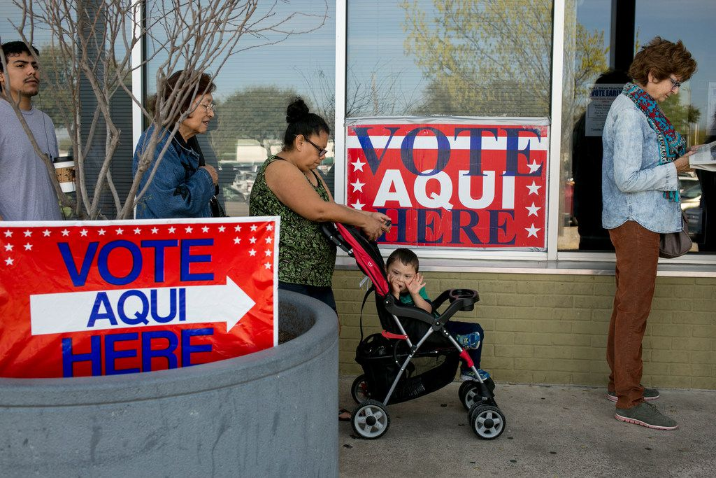 Voters wait in line in Austin on March 1, 2016. Even with millions of Latinos becoming newly eligible to vote every election cycle, many fail to cast ballots. Whether Latinos will turn out in large numbers this midterm election remains a big question.