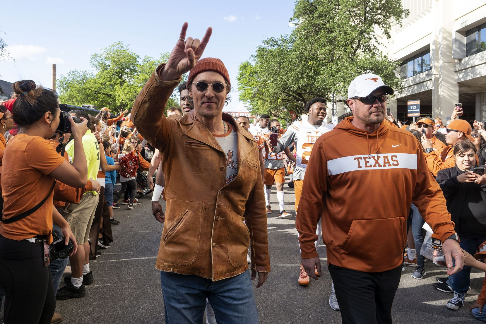 Actor Matthew McConaughey and University of Texas football coach Tom Herman marched with players before the start of the Orange and White spring game in April 2019.