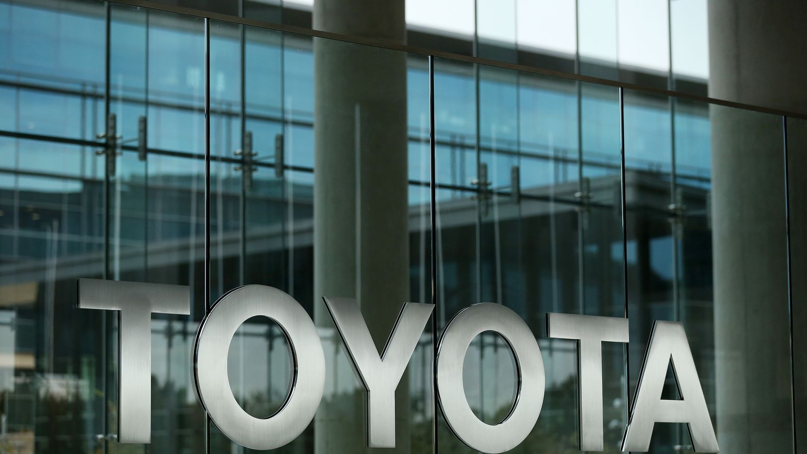 A sign at the front entrance of Toyota Motor North America headquarters in Plano.