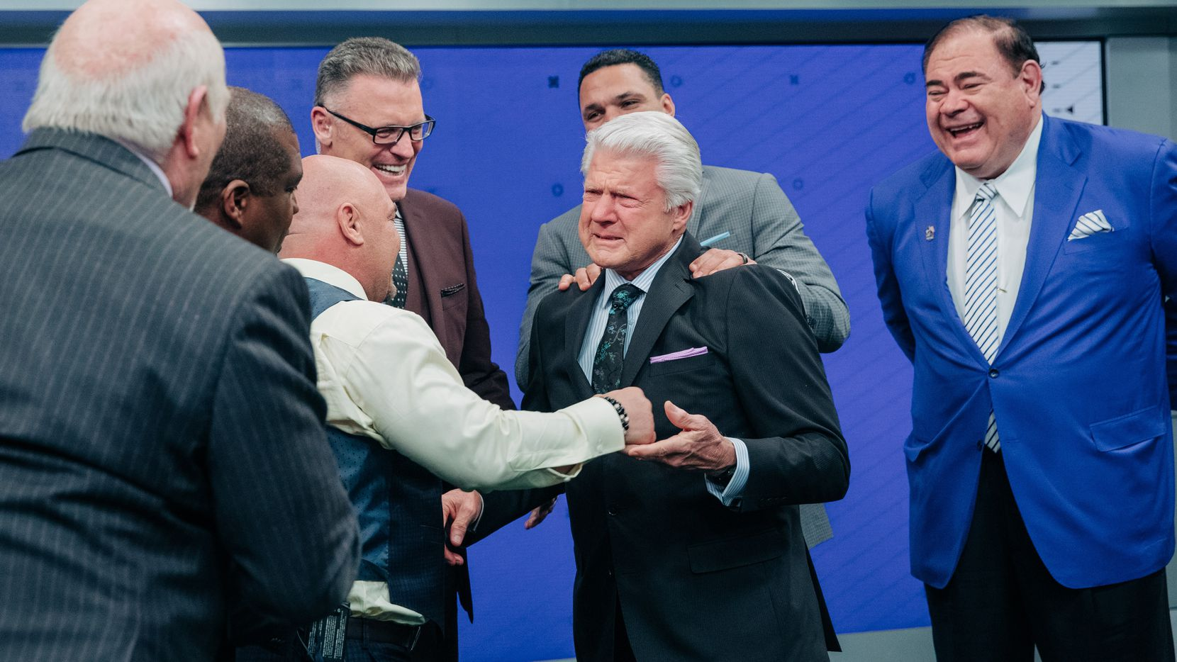 Jimmy Johnson's Fox Sports colleagues congratulate him after Johnson received the news that he'd been elected to the Pro Football Hall of Fame by the Hall's president, David Baker (at right, in blue jacket).