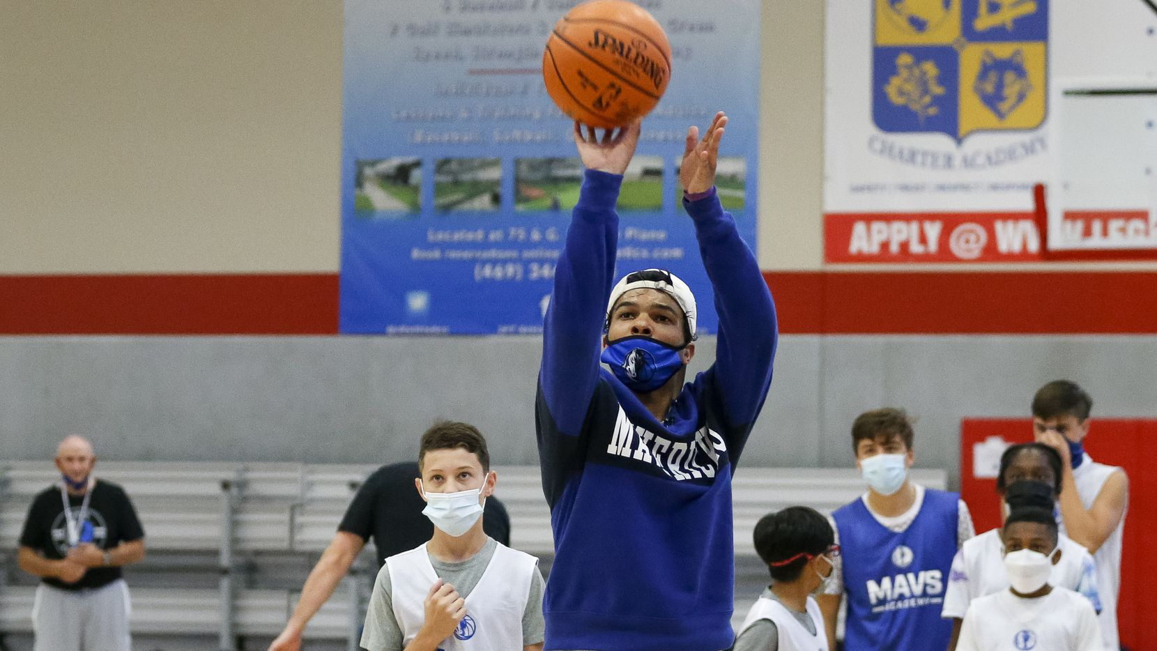 Dallas Mavericks guard Tyrell Terry puts up a shot during a game of knockout at a Mavs Academy Hoop Camp at Plano Sports Authority on Thursday, July 8, 2021, in Plano, Texas.