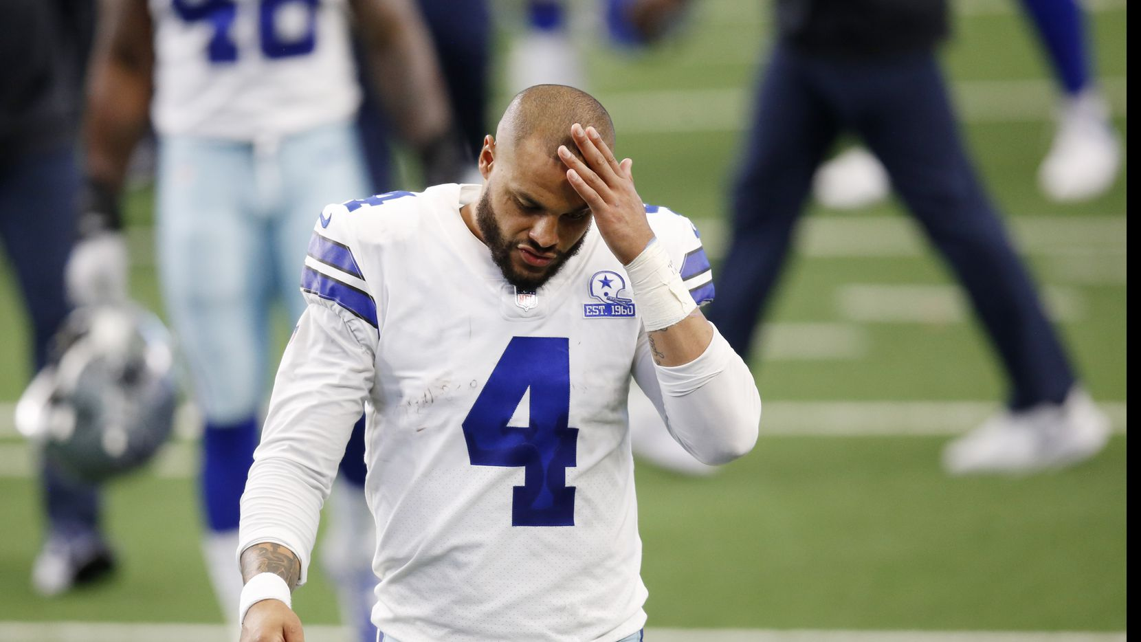Dallas Cowboys quarterback Dak Prescott (4) makes his way off the field after losing to the Cleveland Browns 49-38 at AT&T Stadium in Arlington, Texas on Saturday, October 4, 2020.