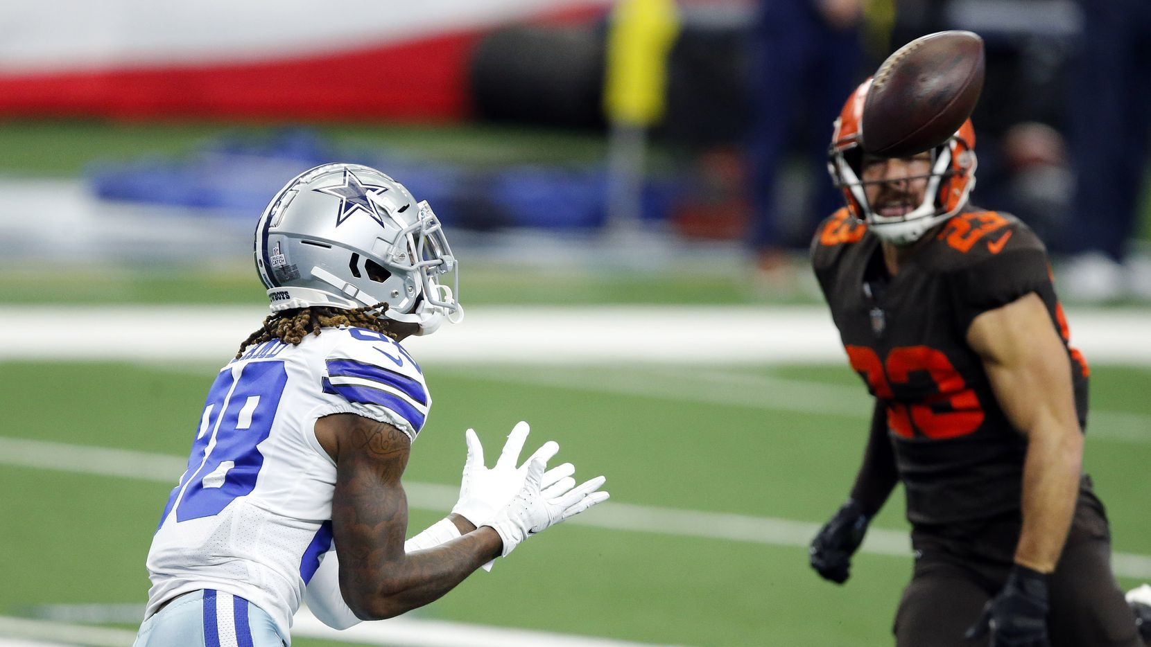 Cowboys wide receiver CeeDee Lamb (88) hauls in a long touchdown against Browns safety Andrew Sendejo (23) during the first quarter at AT&T Stadium in Arlington on Sunday, Oct. 4, 2020.