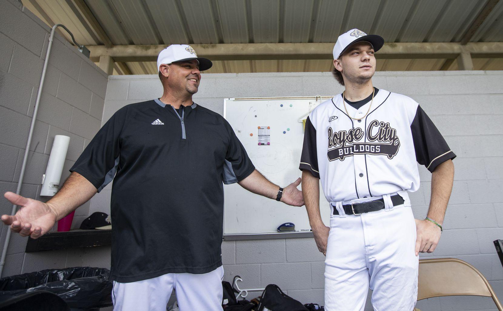 Gavin Lynch, 18, right, talks with head coach Clay Wolfe before a high school baseball game at Royse City High School, Saturday, April 24, 2021.