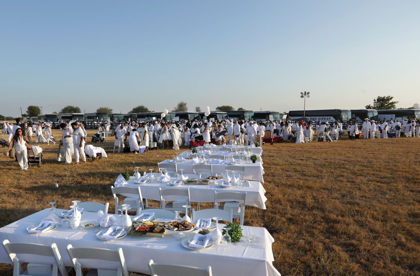 Participants prepare for the Diner en Blanc event at Southfork Ranch in Parker, TX, on Oct. 5, 2019. (Jason Janik/Special Contributor)