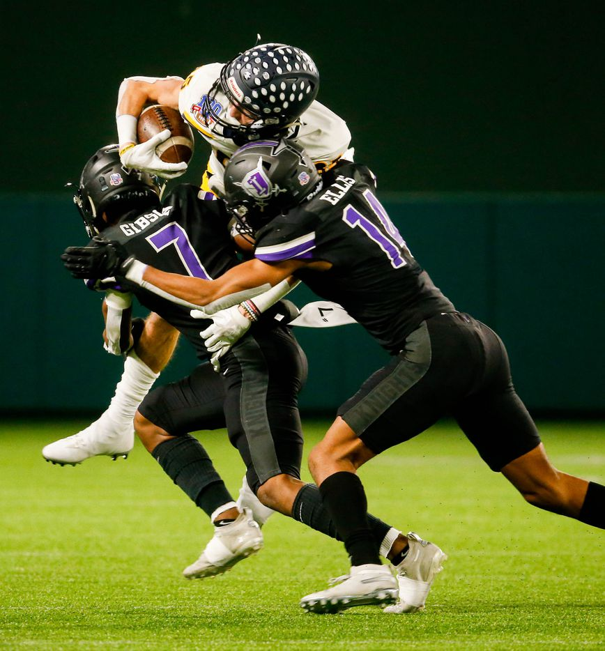 Highland Park's John Rutledge (85) is tackled by Frisco Independence's Andrae Gibson (7) and Caleb Ellis (14) during the first half of a Class 5A Division I area-round playoff game against at Globe Life Park in Arlington on Thursday, Dec. 17, 2020.  (Juan Figueroa/ The Dallas Morning News)