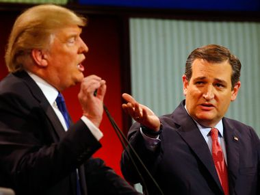 Republican presidential candidates, businessman Donald Trump and Sen. Ted Cruz, R-Texas, argue a point during a Republican presidential primary debate at Fox Theatre, Thursday, March 3, 2016, in Detroit. (AP Photo/Paul Sancya) ORG XMIT: MIKS138
