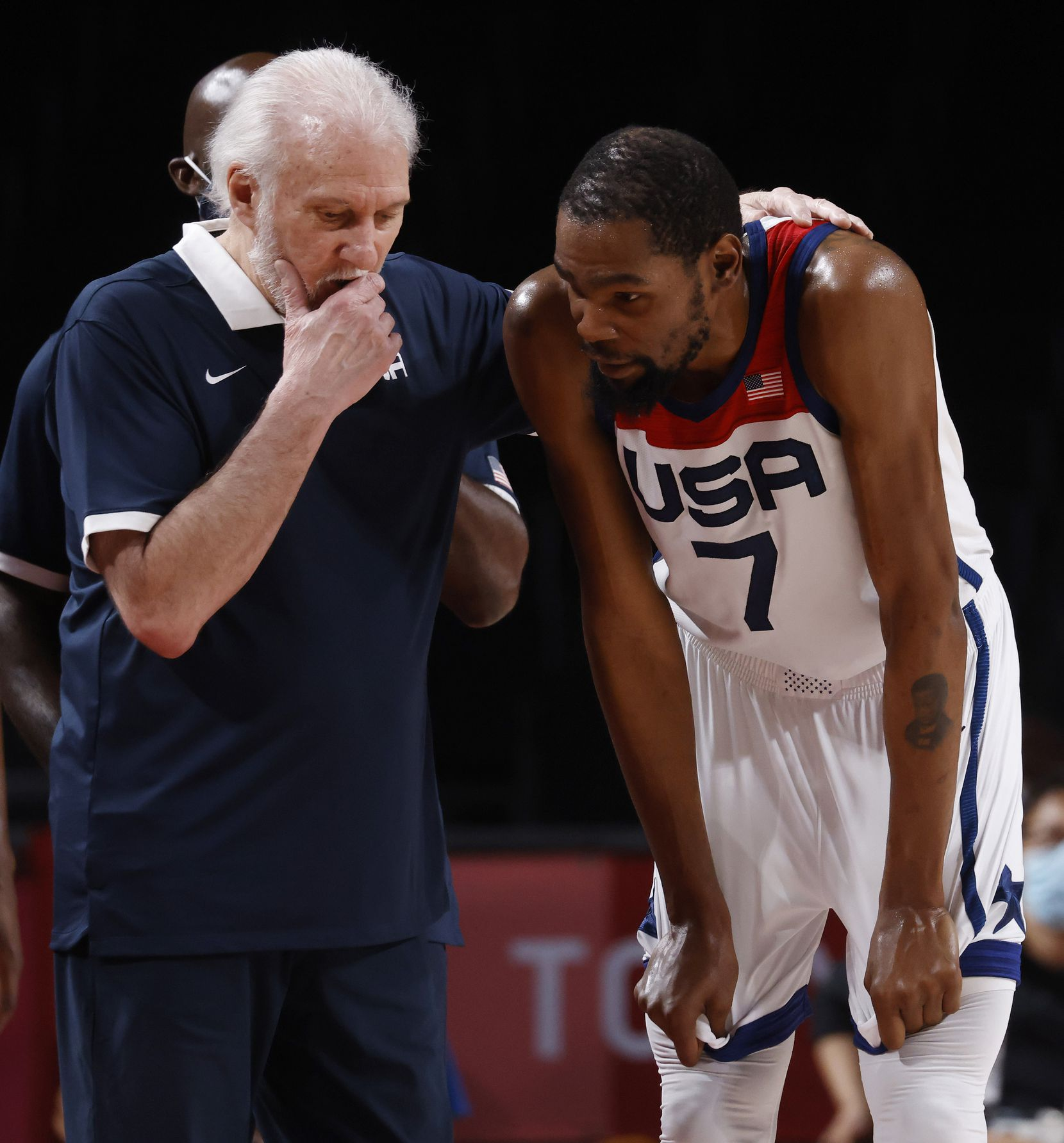 USA's head coach Gregg Popovich talks to Kevin Durant (7) during a break in play against Australia during the second half of a men's basketball semifinal at the postponed 2020 Tokyo Olympics at Saitama Super Arena, on Thursday, August 5, 2021, in Saitama, Japan. USA defeated Australia 97-78 to advance to the gold medal game. (Vernon Bryant/The Dallas Morning News)
