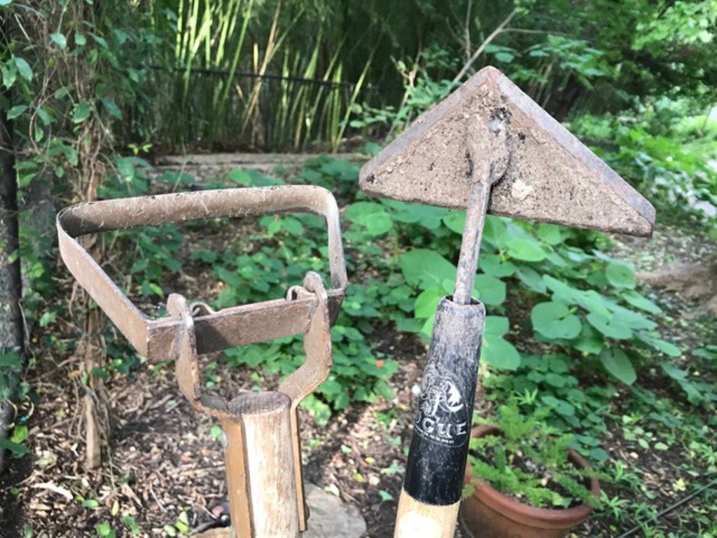 Stirrup hoe or hula hoe on the left is a great weeding tool, but the scuffle hoe on the right is even better.