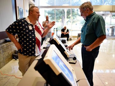 Daniel Bradley, left, Central Count manager for Dallas County Elections, guides Ron Abraham, 75, of Mesquite, with the new voting machine titled ExpressVote, during a demonstration of the new equipment for elections, Sept. 25 at City Hall in Mesquite. Starting this Fall, Dallas voters will use the new equipment as well as visit voter centers to cast their ballot and not the precincts they're used to. Ben Torres/Special Contributor