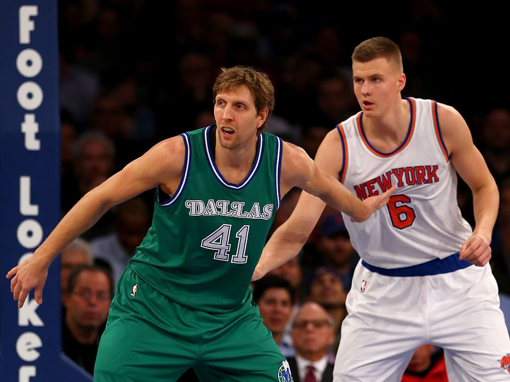 NEW YORK, NY - DECEMBER 07:  Dirk Nowitzki #41 of the Dallas Mavericks and Kristaps Porzingis #6 of the New York Knicks fight for position at Madison Square Garden on December 7, 2015 in New York City. NOTE TO USER: User expressly acknowledges and agrees that, by downloading and/or using this Photograph, user is consenting to the terms and conditions of the Getty Images License Agreement.  (Photo by Elsa/Getty Images)