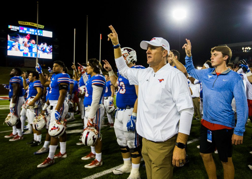 Southern Methodist Mustangs head coach Chad Morris sings the school song with his team after a 54-32 win over the North Texas Mean Green after a football game between UNT and SMU on Saturday, September 9, 2017 at SMU's Ford Stadium in Dallas. (Ashley Landis/The Dallas Morning News)