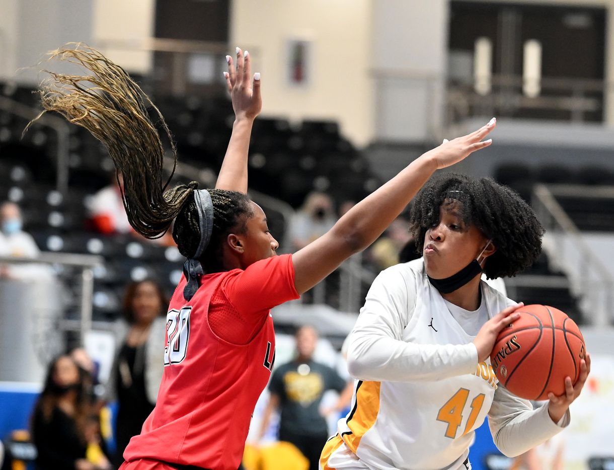 Memorial's Brynn Lusby (41) looks to drives on Liberty's Jazzy Owens-Barnett in the first half of a Class 5A girls high school playoff basketball game between Frisco  Memorial and Frisco Liberty, Wednesday, Feb. 24, 2021, in Frisco, Texas. (Matt Strasen/Special Contributor)