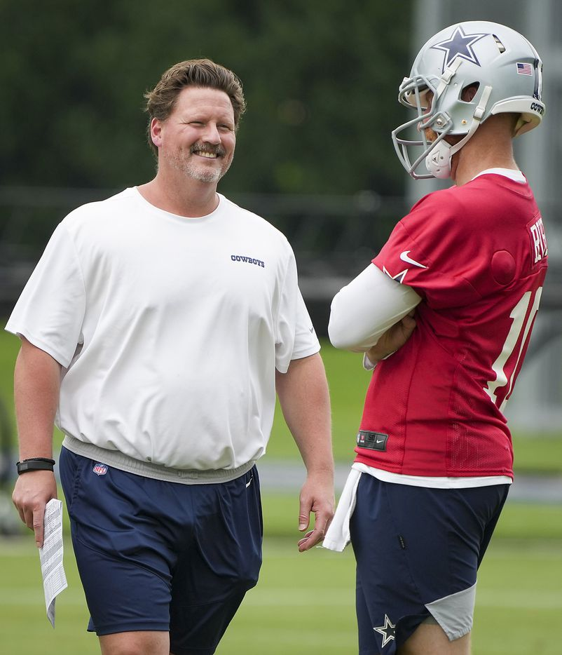 Dallas Cowboys consultant Ben McAdoo talks with quarterback Cooper Rush during a minicamp practice at The Star on Wednesday, June 9, 2021, in Frisco. (Smiley N. Pool/The Dallas Morning News)