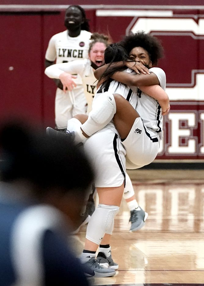 Dallas Bishop Lynch's Madison Cockrell (5) jumps into the arms of Talia Depetrillo (11) after defeating The Village School in the TAPPS 6A girls basketball championship game at A&M Consolidated High School in College Station, Texas on Friday, March 12, 2021. (Sam Craft/Special Contributor)