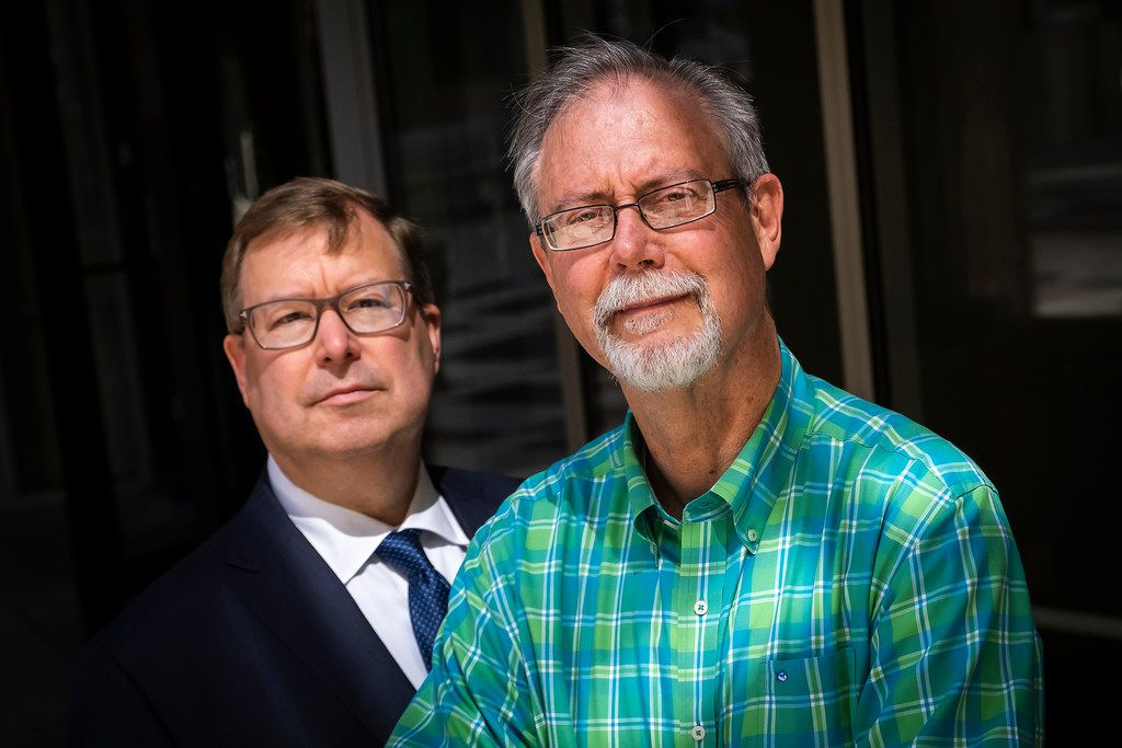 John Rogers (right), with attorney John Palter outside the offices of Palter Sims Martinez in Dallas, said he dismissed his suit after getting a message from God.
