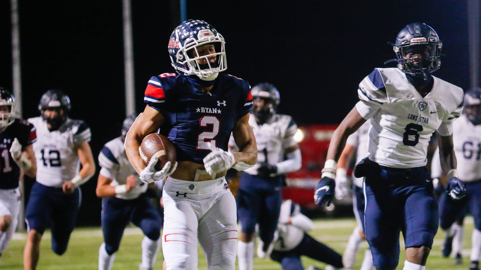 Denton Ryan's Billy Bowman Jr. (2) runs the ball during the second quarter of a football game against Frisco Lone Star at the C.H. Collins Complex in Denton on Thursday, Dec. 4, 2020. The game is tied at halftime, 14-14.