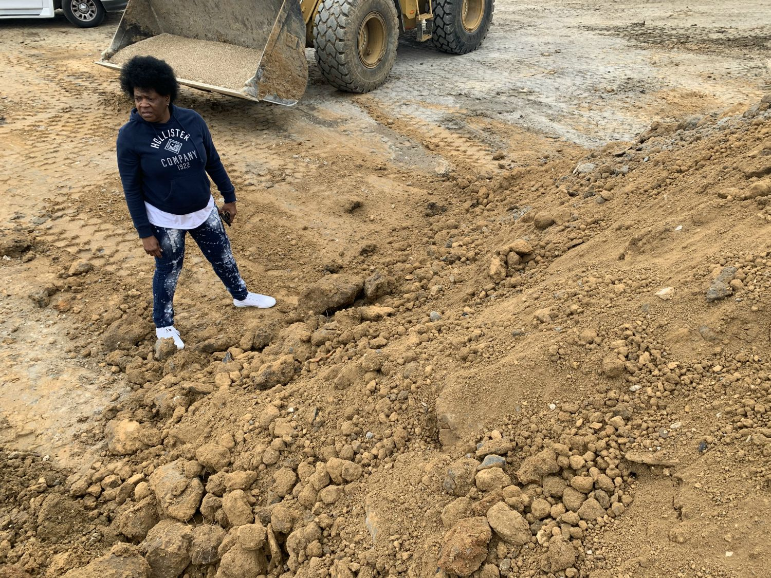 Diane Smith, a West Dallas native, told City Hall about the uncovered piles of dirt behind the under-construction 7-Eleven. The city then contacted the Environmental Protection Agency.