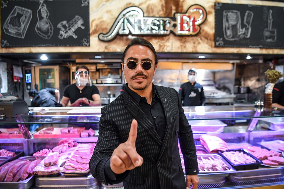 "Turkish restaurateur Nusret Gokce, or ""Salt Bae,"" poses for photos at his restaurant in Instanbul, Turkey, after its reopening on June 1, 2020."