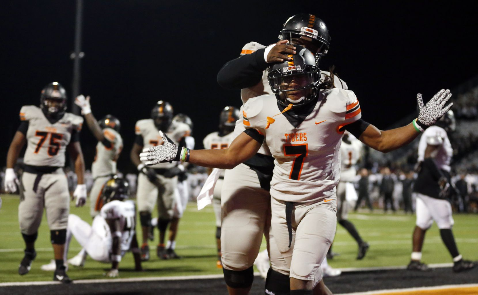 Lancaster running back Karon Neblett (7) celebrates his fourth quarter touchdown with teammate Willie Armstrong (71) against The Colony in their Class 5A Division I first-round playoff game at Tiger Stadium in Lancaster, Thursday, November 14, 2019. Lancaster won, 44-29. (Tom Fox/The Dallas Morning News)