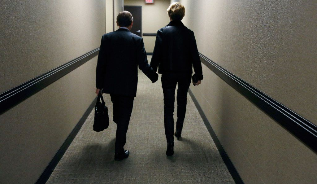 Laura Miller and her husband, Steven D. Wolens, leave her doctor'€™s office. (David Woo/The Dallas Morning News)