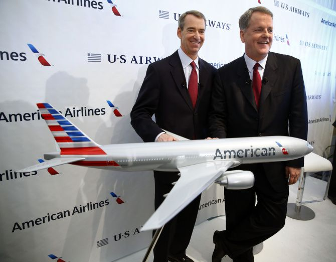 American Airlines CEO Tom Horton (left) and US Airways CEO Doug Parker announced the airlines' merger in February.
