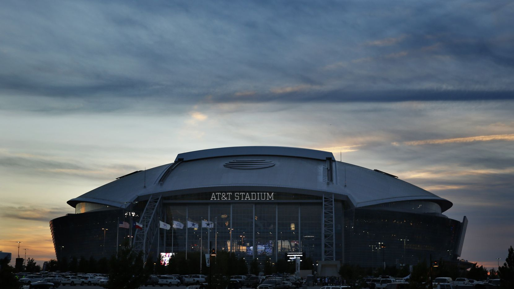 AT&T Stadium is seen at sunset before the Dallas Cowboys Washington Redskins game, Monday, October 27, 2014. (Tom Fox/The Dallas Morning News)  exterior building mug overall architecture facade