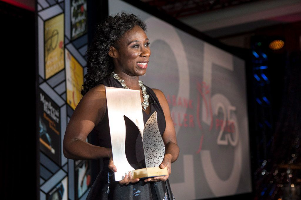 Esi Edugyan poses for a photo on stage after winning the Scotiabank Giller Prize for  Washington Black at the gala in Toronto on Monday, Nov. 19, 2018.