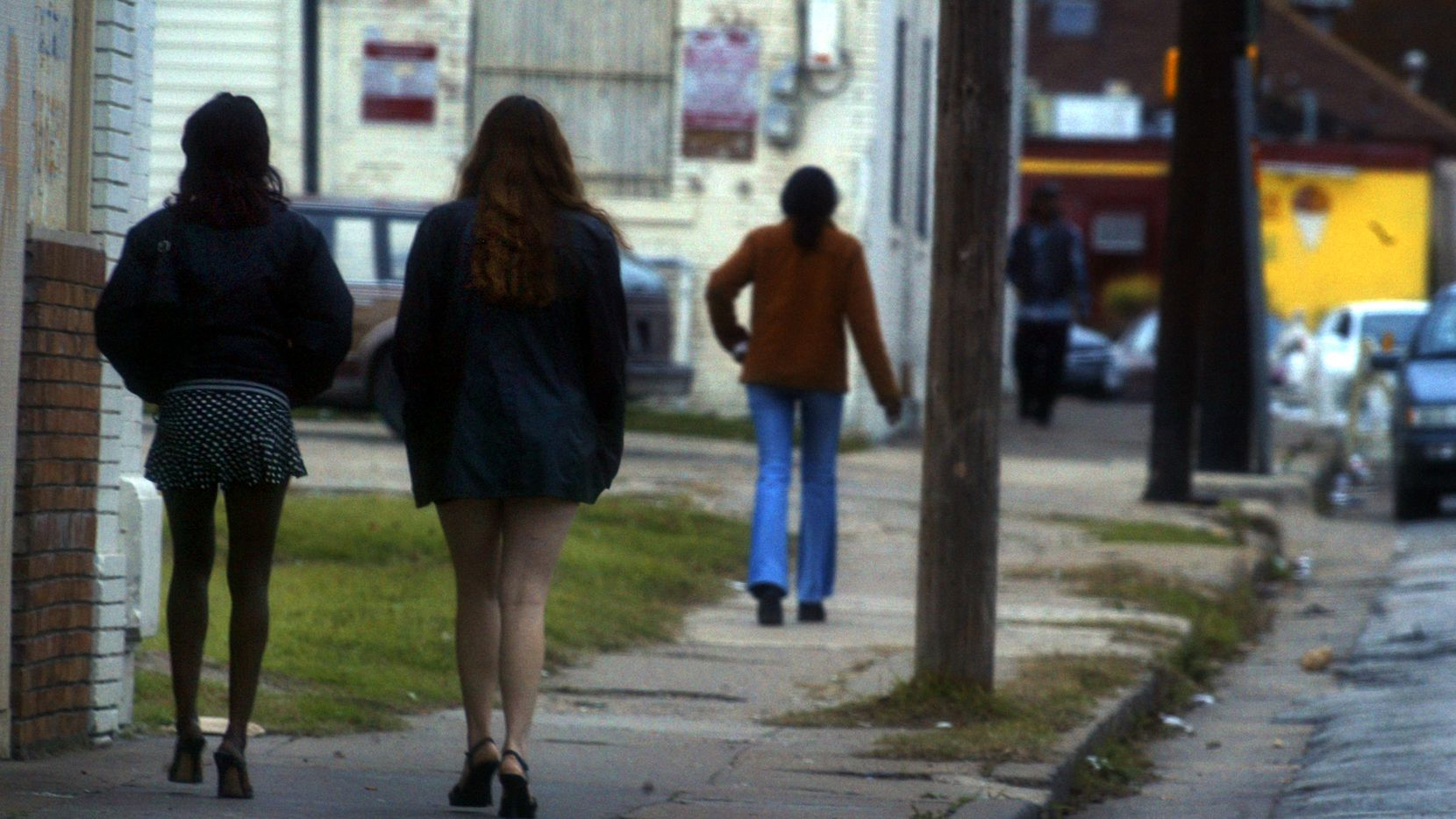 Prostitutes walk a Dallas street on a weekend afternoon.