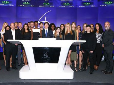 Mark Schwarz and other executives of Wilhelmina International Inc. rang Nasdaq's closing bell on September 16, 2015.