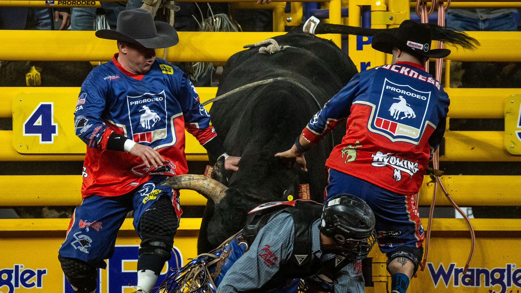 From left, bullfighters Nate Jestes and Dusty Tuckness redirect Audacious the bull during the bull riding event on the sixth night of the National Finals Rodeo at Globe Life Field in Arlington, Texas, on Tuesday, Dec. 10, 2020.