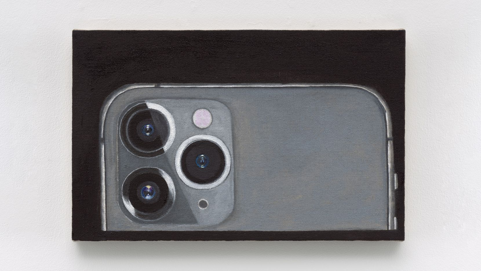 "Leidy Churchman's ""iPhone 11"" (2019-20) depicts the smartphone set upon its side and mimicking another painting in the exhibition of the Buddha reposed, the phone's anthropomorphic three-circled camera lenses squarely facing us. Churchman's ""Focus"" exhibition runs through March 21 at the Modern Art Museum of Fort Worth."