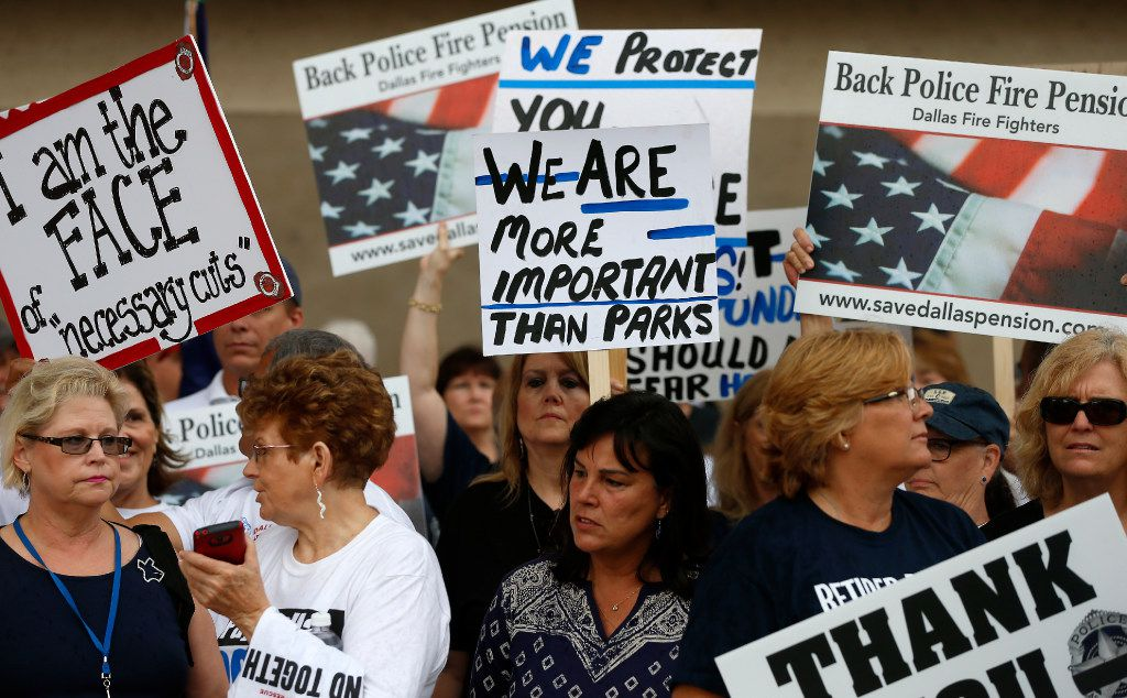 Dallas police and fire retirees gather holding pickets during a rally against Mayor Mike Rawlings' letter, which asked taxpayers to support in making changes to a proposed Dallas Police and Fire pension bailout, at the City Hall in Dallas, Wednesday, April 26, 2017. (Jae S. Lee/The Dallas Morning News)