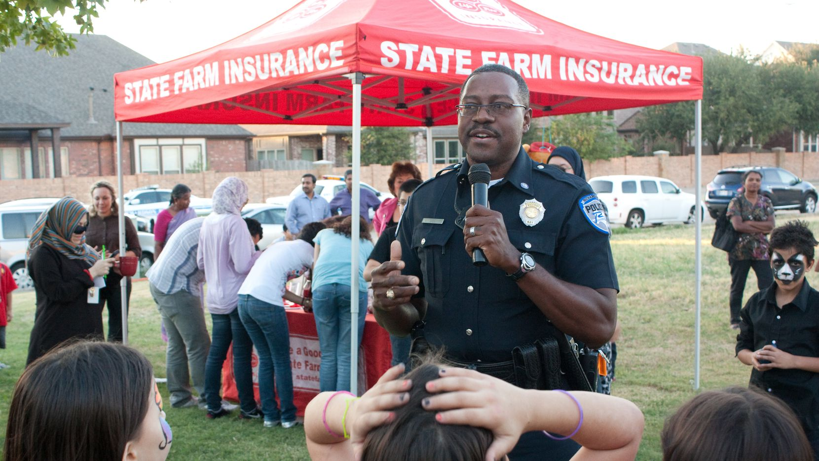 In this 2011 file photo, Richardson Police Department crime prevention officer Frank Bradford speaks to the crowd at the Buckingham Park National Night Out block party. The city's National Night Out program this year was recognized for adapting to the limitations required by the pandemic.