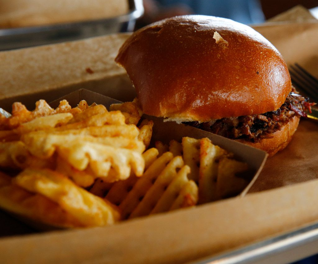 A pulled pork sandwich with fries at Ferris Wheelers Backyard & BBQ in Dallas on Sept. 25, 2017.   (Nathan Hunsinger/The Dallas Morning News)