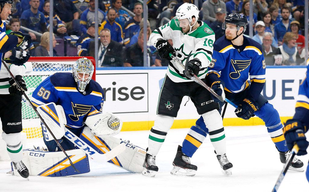 Dallas Stars center Jason Dickinson (16) tries to deflect a shot past St. Louis Blues goaltender Jordan Binnington (50) during the first period at the Enterprise Center in St. Louis, Tuesday, May 7, 2019. The teams were playing in the Western Conference Second Round Game 7 of the 2019 NHL Stanley Cup Playoffs. (Tom Fox/The Dallas Morning News)