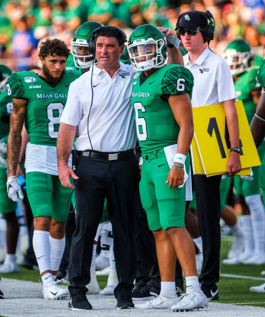 UNT head coach Seth Littrell talks with quarterback Mason Fine on the sidelines during the first half of an NCAA football game against SMU at Ford Stadium on Saturday, Sept. 7, 2019, in Dallas. (Smiley N. Pool/The Dallas Morning News)