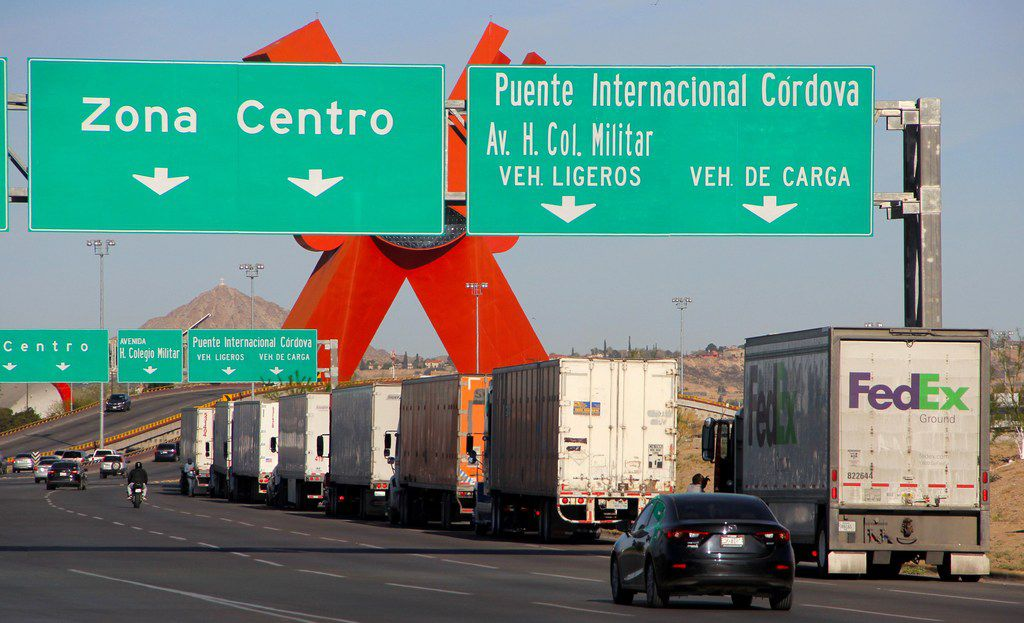 Trucks such as these near the U.S.-Mexico border in Ciudad Juarez are still boosting trade, and a Mexican business association says companies have not retreated from the border. But if uncertainty continues over future policies, an economist believes that business investment will decline.